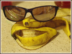 Arrangement of banana peels and eyeglasses as an imaginary human face.